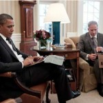 President Obama receives a briefing on an Apple iPad