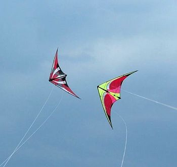 English: Two dual line stunt kites flying in a...
